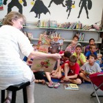 summer reading group hearing a book about veggies